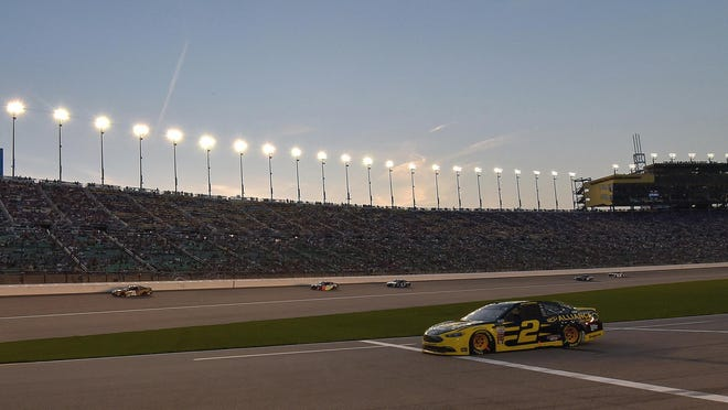 Driver Brad Keselowski pulls out of the pits as the sun sets May 12, 2018, at the Kansas Speedway in Kansas City, Kan. The Speedway is a poster child for success for the STAR Bonds program, which state lawmakers are now debating whether to extend.