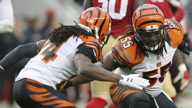 Bengals outside linebacker Vontaze Burfict (right) and cornerback Adam Jones celebrate a defensive stop in the fourth quarter against the 49ers.