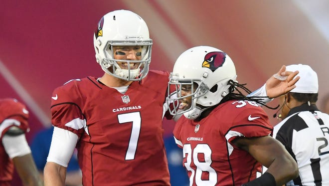 Arizona Cardinals running back Andre Ellington (38) celebrates his 3-yard touchdown run with quarterback Blaine Gabbert during the first half against the Dallas Cowboys in the Pro Football Hall of Fame NFL preseason game in Canton, Ohio, Thursday, Aug. 3, 2017. (AP Photo/David Richard)