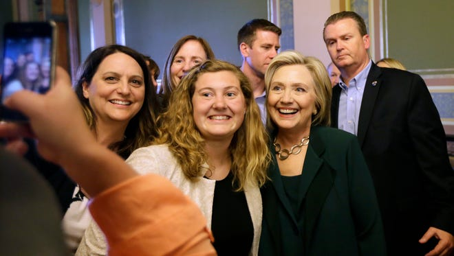 Democratic presidential candidate Hillary Clinton poses for a photo with Simpson College students on April 15 in Des Moines, Iowa.