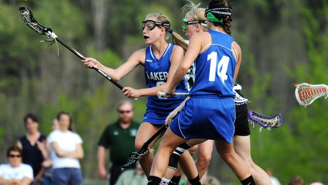 Colchester's Brooke Senesac wins possession with teammate Kelsey Cauchon and St. Johnsbury's Sam Turgeron in the mix during the Lakers' 13-7 Division II lacrosse win on Friday afternoon.