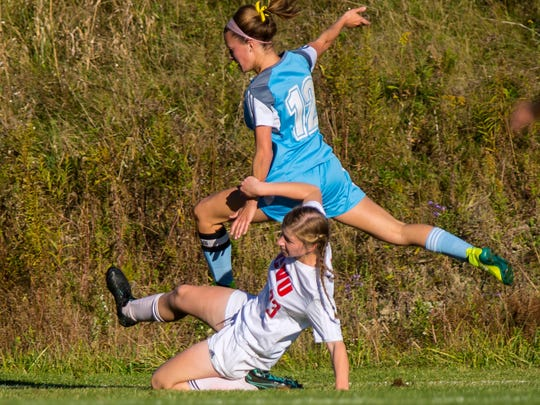 CVU's Emma Hoechner, bottom, tackles South Burlington's Cameron Peyko in Hinesburg on Tuesday, October 11, 2016.