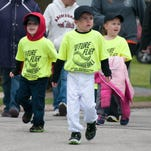 Hundreds of children participated in the annual Little League parade through Clyde on Friday evening.