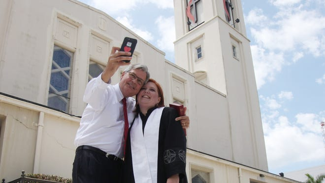 Mayor Randy Henderson takes a selfie with Pastor Melanie Fierbaugh after their last service at the First United Methodist Church on Sunday.