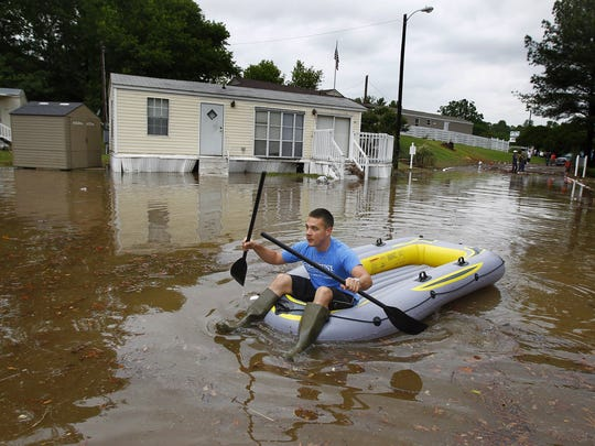 Everett Bryant paddles his way to his mobile home in Memphis Mobile City on Thomas near Watkins on May 1, 2011.