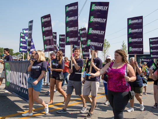 Senator Joe Donnelly participants march in the Indy
