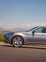 The 2014 Infiniti Q70 shows off its curves while hugging the road's.