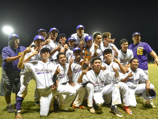 The George Washington Geckos celebrate after winning the IIAAG Boys' Baseball League championship game against John F. Kennedy High School at Okkodo field on Dec. 19.