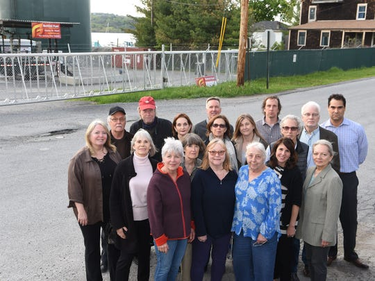 A group of residents from New Hamburg stand in front of the Bottini Fuel petroleum storage facility on Point Street. Standing in the front row, from left to right, are Dale Cunningham, Polly Myhrum, Marian Ferris, Mary Lulu Lamping, Marjorie Shaner, Andrea Sayago and Susan Barbarisi. In the center row, from left to right, are Cara Ginder, Stacey Mesler, Diane Levitt, Pam Kingsley and Rick Levitt. In the back row, from left to right, are Robert Ginder, Chris Kingsley, Greg Freeman, Colin Cuite, Dan Fannon and Ed Sayago.