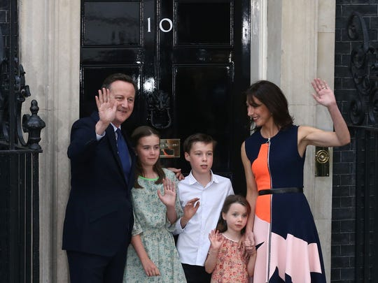 Outgoing British prime minister David Cameron waves