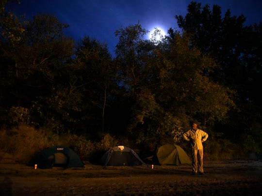 John Guider stands outside his camp along the banks of Tennessee River on Oct. 11, 2016, in Parsons, Tenn.