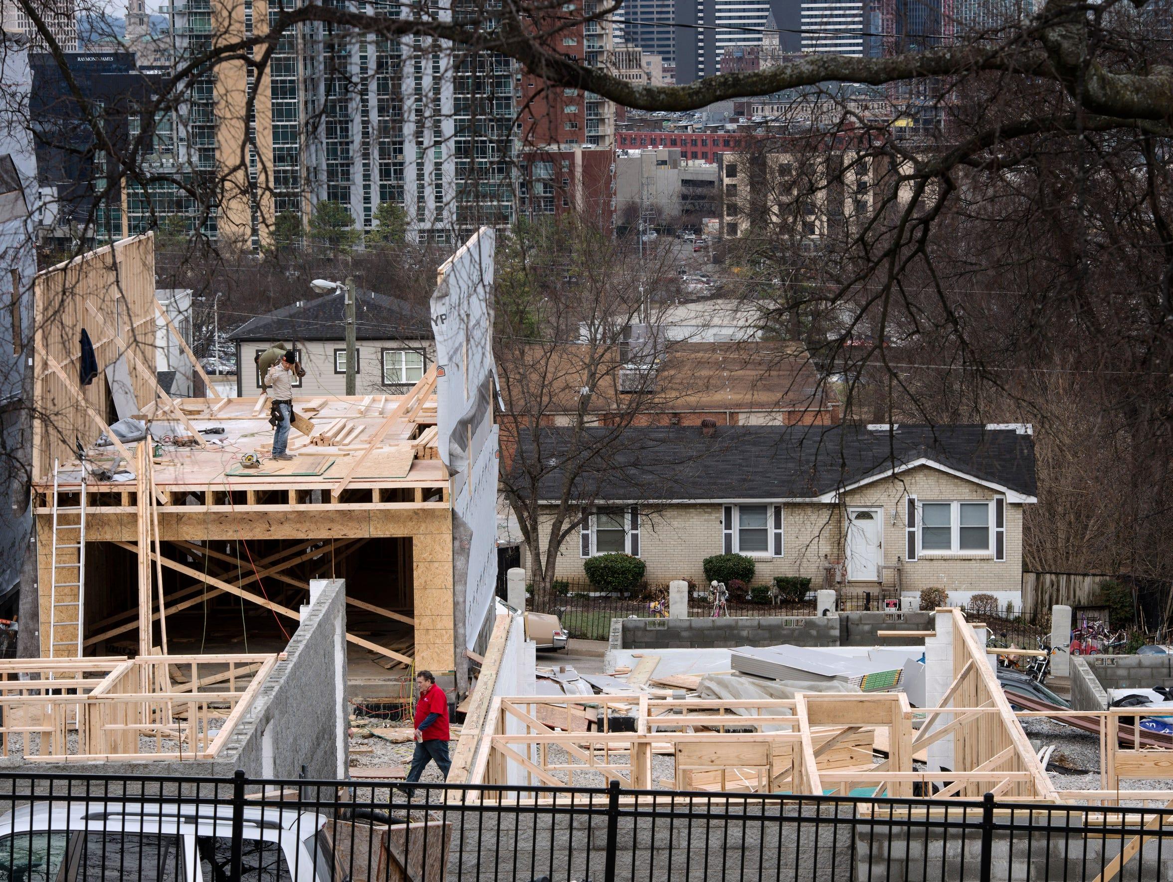New houses go up along Archer Street in a neighborhood