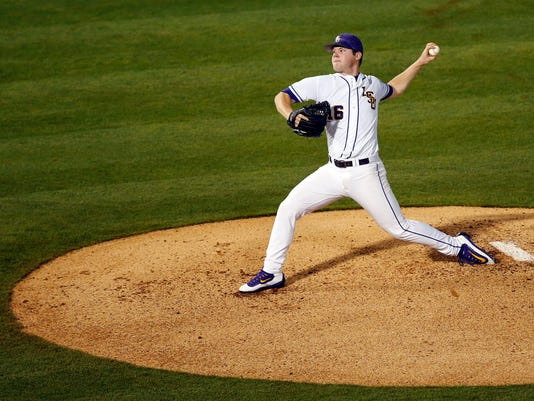 LSU pitcher Jared Poche' delivers the ball against Mississippi State during the first inning of a Southeastern Conference NCAA college baseball tournament game at the Hoover Met, Thursday, May 26, 2016, in Hoover, Ala. (AP Photo/Brynn Anderson)