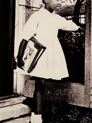 Barbara Gant on her way to school.