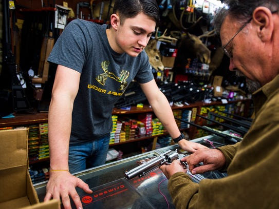 Redding's Hardware sales associate Lane Hartley shows
