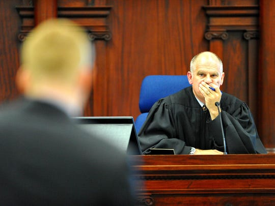 Judge John Kutzman presides over the initial appearance of Branden Miesmer on Friday.