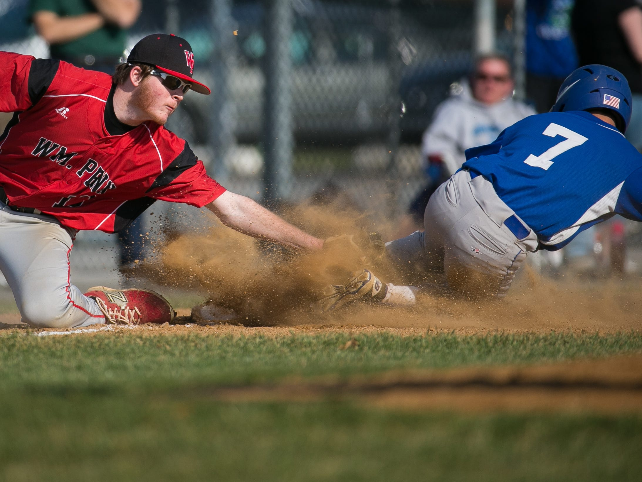 Dominic Durante (7) of fifth-ranked St. Georges slides safely into third as William Penn's Matthew North is late with the tag last Thursday.