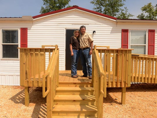 Dave and Bobbie Ann Boroughs stand in front of their new school building at Sheltering Tree Ranch in Savannah.