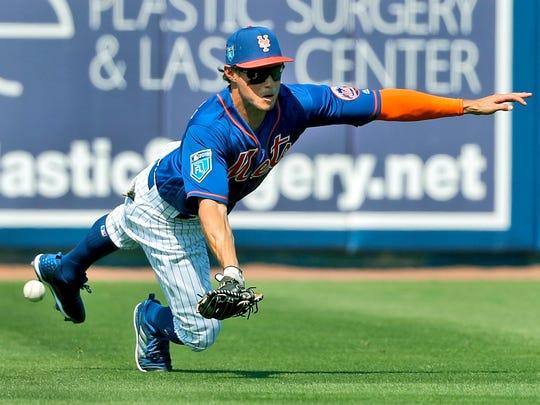 Outfielder Matt den Dekker was called up from Class AAA Las Vegas by the Mets on Wednesday.