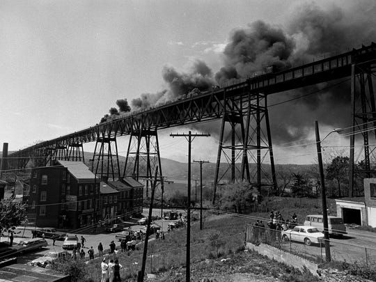 In this file photo, the Poughkeepsie Railroad Bridge, now the Walkway Over the Hudson, caught fire and was badly damaged on May 8, 1974. The bridge was never used again for rail transportation. The view looks west from Poughkeepsie toward the Hudson River.