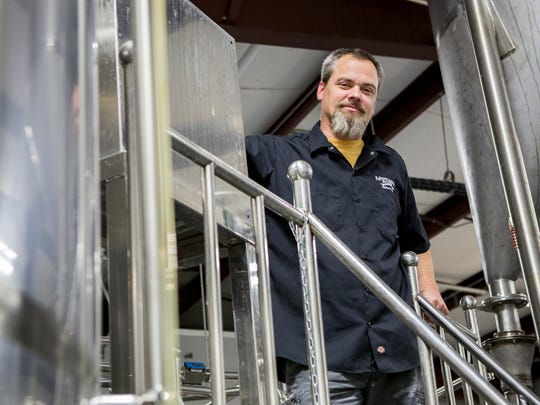 Eric Williams, president and co-founder of the The Mispillion River Brewing Co., poses for a portrait in the brewery in Milford.