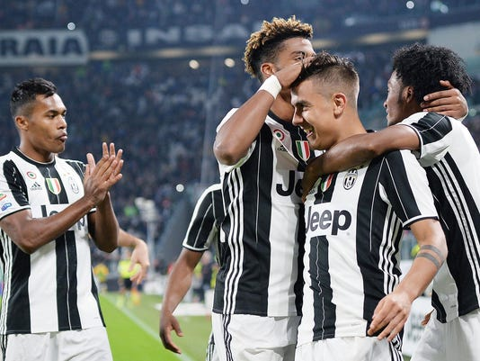 Juventus' Paulo Dybala, second from right, celebrates with teammates after scoring during a Serie A soccer match between Juventus and Udinese, at the Juventus Stadium in Turin, Italy, Saturday, Oct. 15, 2016. (Alessandro Di Marco/ANSA via AP)