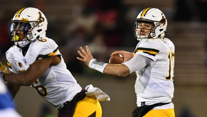 Wyoming Cowboys quarterback Josh Allen (17) prepares to pass the ball in the second quarter against the Air Force Falcons.