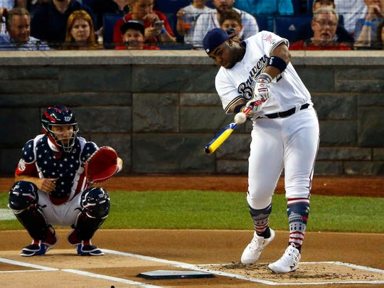 Milwaukee Brewers first baseman Jesus Aguilar (24)  swings during the 2018 MLB home run derby at Nationals Ballpark.