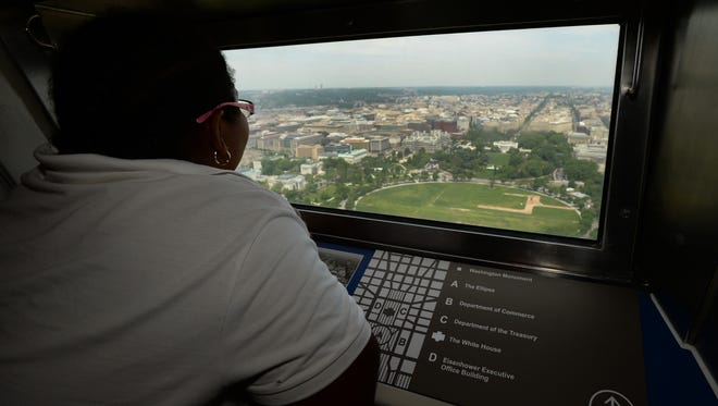 Nastacia Wilkerson, 9, a student at Aiton Elementary School in Washington, was among the first to take in the view from the newly-reopened Washington Monument.