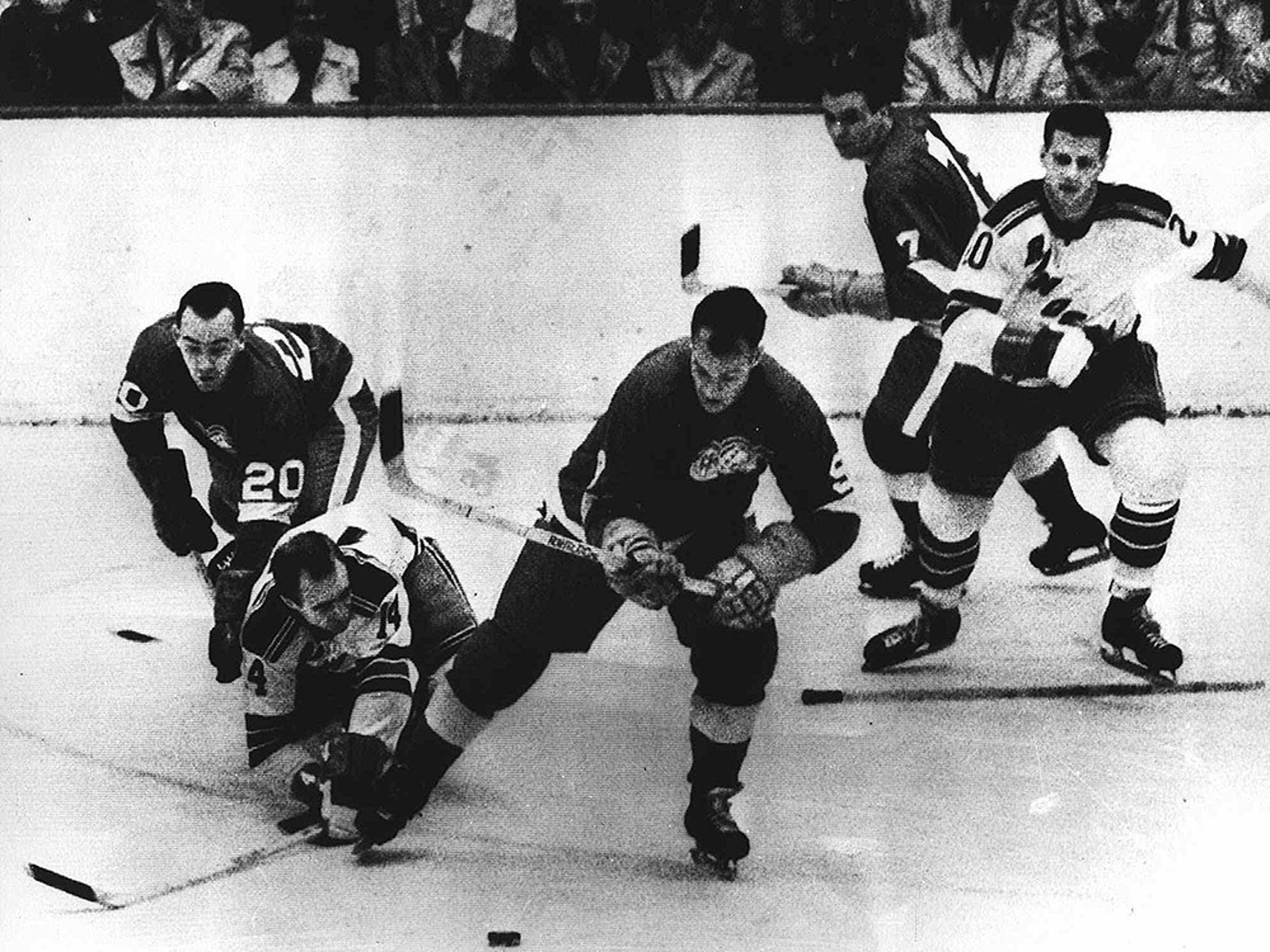 Gordie Howe, with the puck, playing for the Red Wings against the Rangers in November 1963.