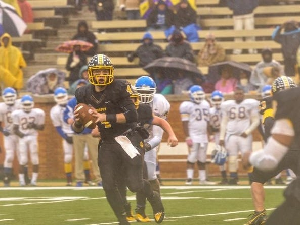 Dalton Kent quarterbacked Murphy to a NCHSAA 1-A football championship in 2013.