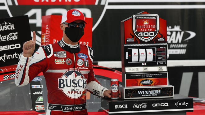 Kevin Harvick celebrates after winning during a NASCAR Cup Series auto race at Michigan International Speedway in Brooklyn, Mich., Saturday, Aug. 8, 2020.