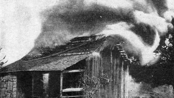 House in Rosewood, Fla., burns in January 1923 as part of the destruction of an African-American town.