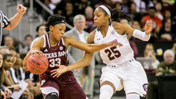 Jan 26, 2015; Columbia, SC, USA; Texas A&M Aggies guard Courtney Walker (33) tries to gain control of the ball as South Carolina Gamecocks guard Tiffany Mitchell (25) defends. Mitchell and the No. 2 Gamecocks face Missouri on Sunday.