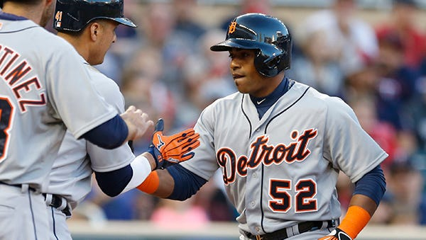 Yoenis Cespedes is welcomed home after his three-run homer Monday night.