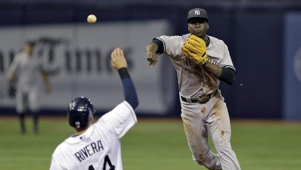 Yankees shortstop Didi Gregorius forces out Tampa Bay Rays' Rene Rivera (44) at second base and relays the ball to first base in time to turn a double play on Kevin Kiermaier during the fourth inning of a Thursday's game.