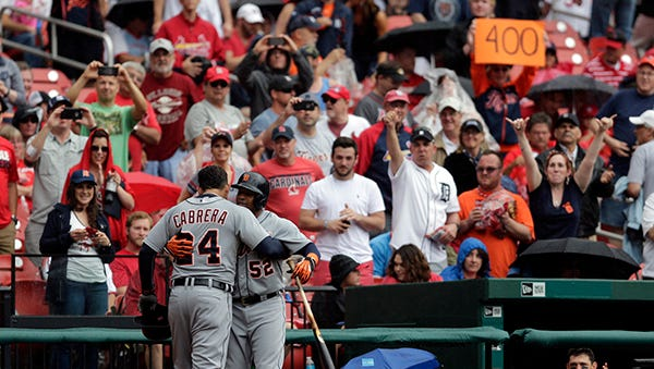 Miguel Cabrera gets a hug from teammate Yoenis Cespedes after hitting a solo home run during the first inning for No. 400 Saturday.