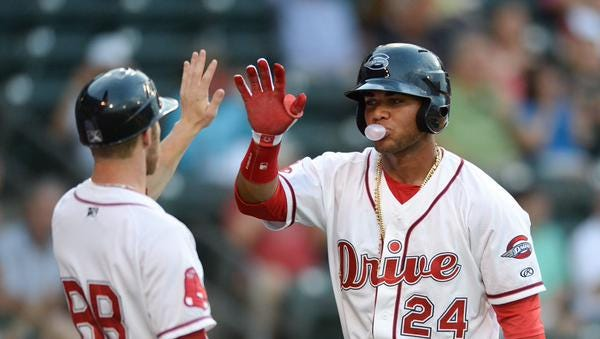 Greenville Drive second baseman Yoan Moncada after scoring in the third inning against the Lexington Legends Monday night at Fluor Field