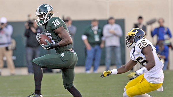 MSU's Aaron Burbridge makes a catch against Michigan last season.