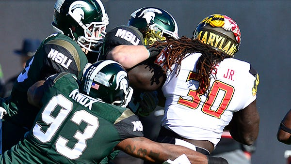 Spartan defenders gang up on Maryland's Kenneth Goins Jr. on Saturday.