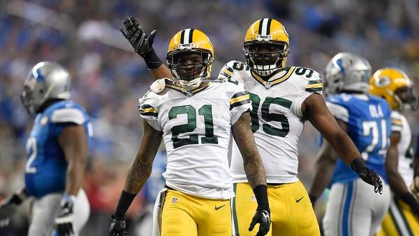 Green Bay Packers teammates Ha Ha Clinton-Dix (21) and Datone Jones (95) celebrate a big defensive play against the Detroit Lions at Ford Field.