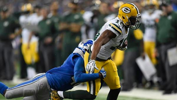 Green Bay Packers receiver Randall Cobb tried to break a tackle against the Detroit Lions at Ford Field.
