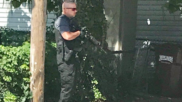 Officer on 8th Street in Newport after a report of an armed robbery