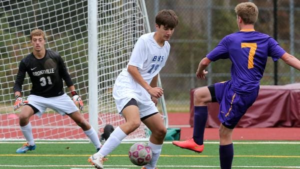 Bronxville's Mike Calabrese defends and blocks a shot by Rhinebeck's Ryan Euell during their boys soccer Section 1 vs. Section 9 Challenge game at Valhalla High School Monday. Bronxville lost 2-1.