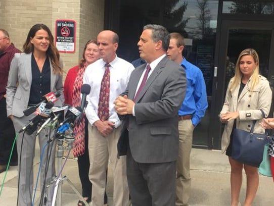 Cal Harris and lead defense attorney Bruce Barket address