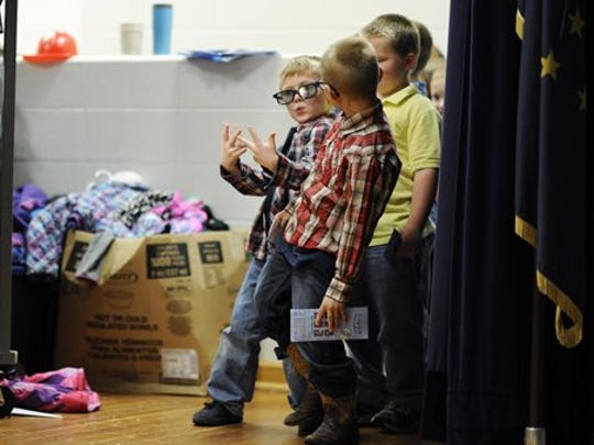 Dylan Moore, left, and Dawson Hoegeman, both 6,  wait in line during picture day at Templeton Elementary School, in Bloomington, Ind., Tuesday, Sept. 15, 2015.