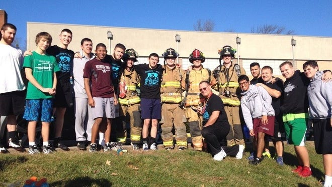 Four firefighters - Nick Cianciara, Jimmy Sumka, Greg Heiner and Christopher DeBiasse - donned full turnout gear, including SCBA packs, to run four miles to Rutgers Prep in an effort to raise funds and awareness for former RPS Wrestler Brett Epps, who is fighting FSGS, a rare kidney disease. The RPS wrestling team, wrestling alumni and coaches turned out, along with other well wishers to cheer the runners on.