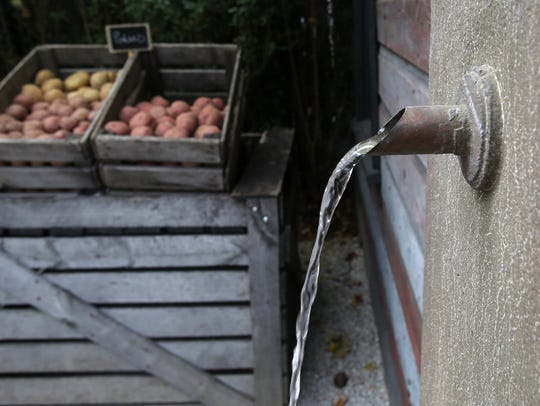 Water flows out a spout at Blue Barn Farm Market at