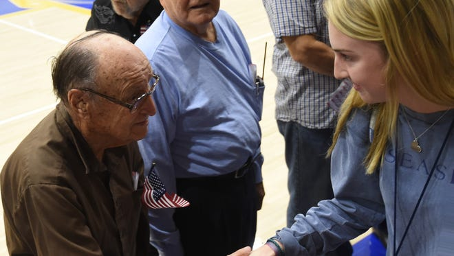"""Mountain Home High School students shake hands with veterans following Friday's """"Freedom is Not Free"""" veterans program at The Hangar."""