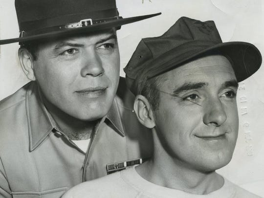 Frank Sutton poses with Jim Nabors for a promotional